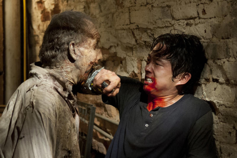 "Glenn (Steven Yeun) and a walker in ""The Walking Dead"" episode, ""When the Dead Come Knocking."""
