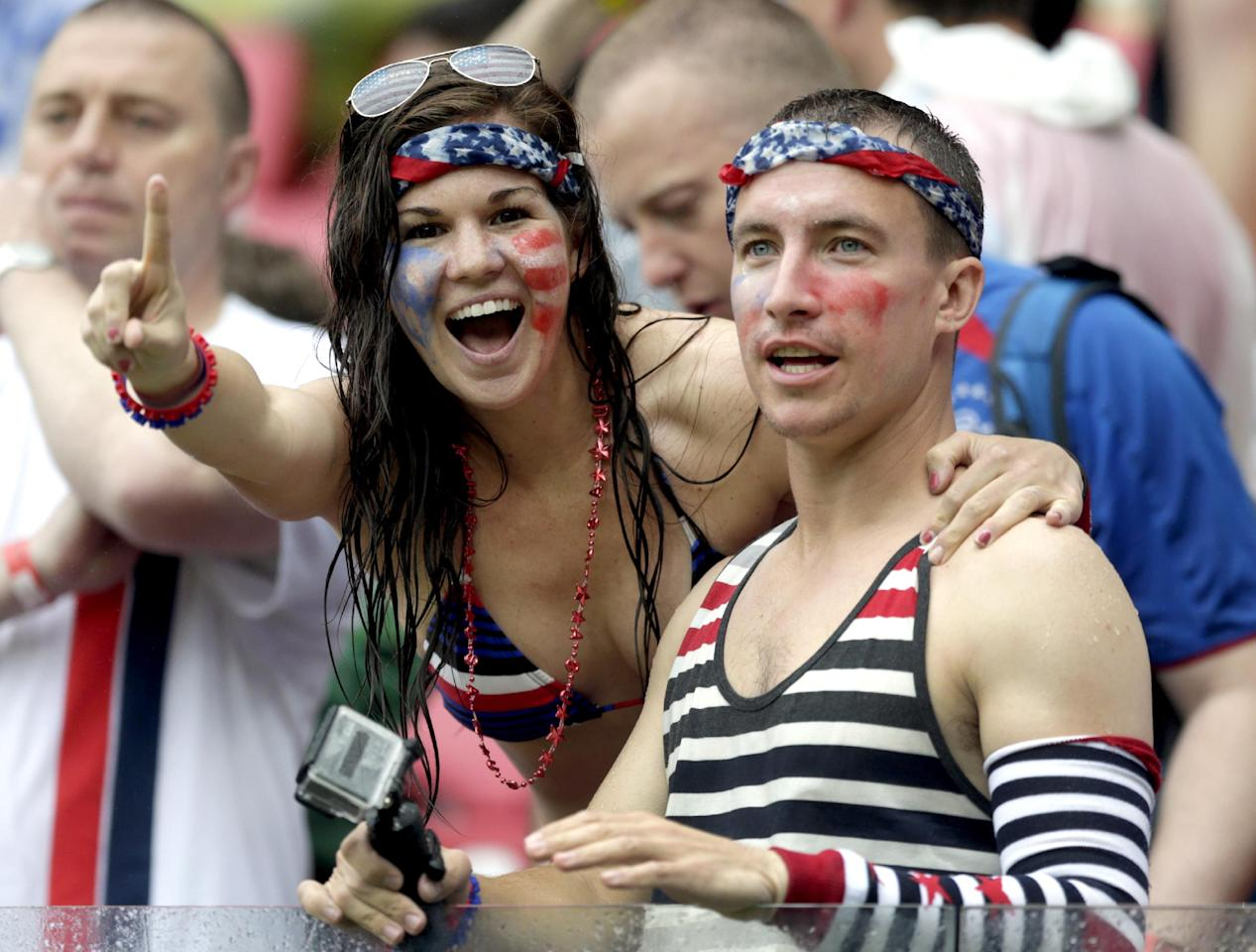 USA supporters cheer their national team during the group G World Cup soccer match between the United States and Germany at the Arena Pernambuco in Recife, Brazil, Thursday, June 26, 2014. (AP Photo/Julio Cortez)