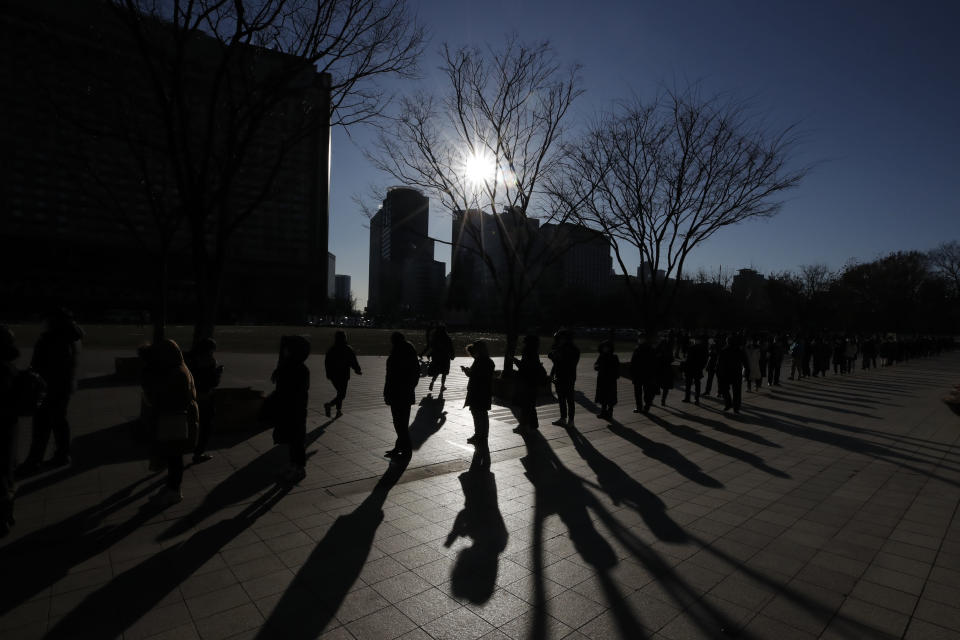 People queue in line to wait for coronavirus testing in Seoul, South Korea on Dec. 17, 2020. South Korea had seemed to be winning the fight against the coronavirus: Quickly ramping up its testing, contact-tracing and quarantine efforts paid off when it weathered an early outbreak without the economic pain of a lockdown. But a deadly resurgence has reached new heights during Christmas week, prompting soul-searching on how the nation sleepwalked into a crisis. (AP Photo/Lee Jin-man)