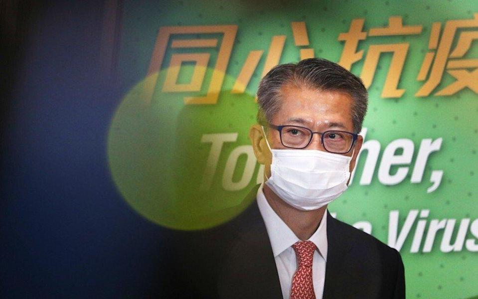 Financial Secretary Paul Chan Mo-po said the city could face a record deficit for the financial year ended in March. Photo: May Tse