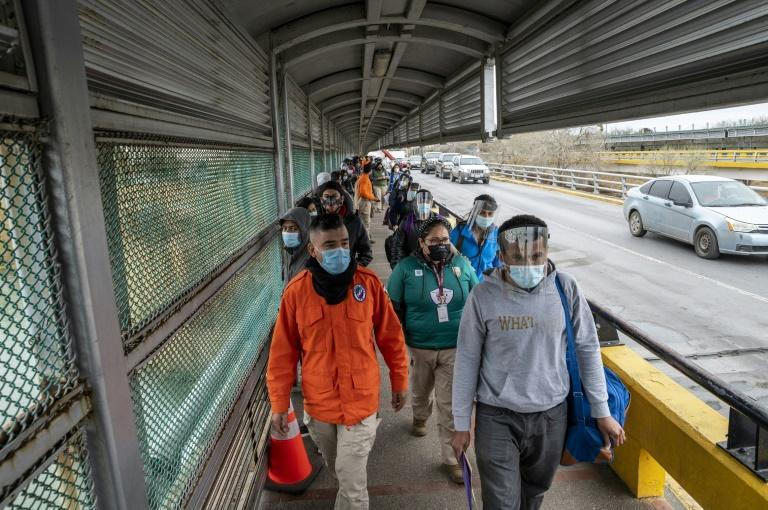 Migrants approach the US border on Gateway International Bridge in Brownsville, Texas on March 2, 2021
