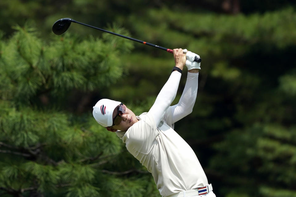 Jazz Janewattananond, of Thailand, hits from the 12th tee during the first round for the men's golf event at the 2020 Summer Olympics, Thursday, July 29, 2021, at the Kasumigaseki Country Club in Kawagoe, Japan, (AP Photo/Matt York)
