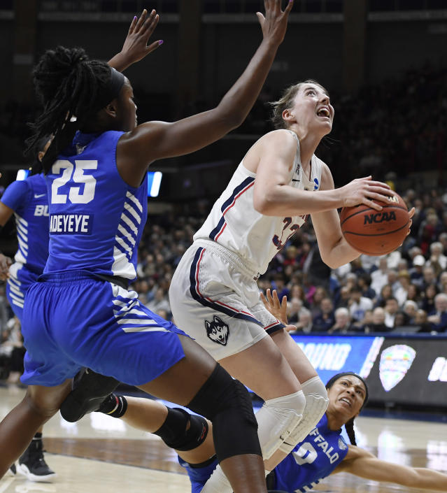 Connecticut's Katie Lou Samuelson shoots as Buffalo's Adebola Adeyeye, left, and Summer Hemphill, bottom right, defend during the first half of a second-round women's college basketball game in the NCAA tournament Sunday, March 24, 2019, in Storrs, Conn. (AP Photo/Jessica Hill)