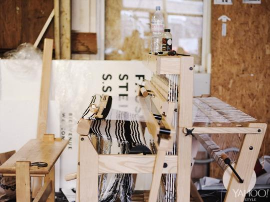 <p>The studio is home to the designer's hand-looms, on which many of her fabrics are woven.</p>