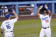 Los Angeles Dodgers' Albert Pujols, right, is congratulated by Will Smith after hitting a two-run home run during the second inning of a baseball game against the Arizona Diamondbacks Thursday, May 20, 2021, in Los Angeles. (AP Photo/Mark J. Terrill)