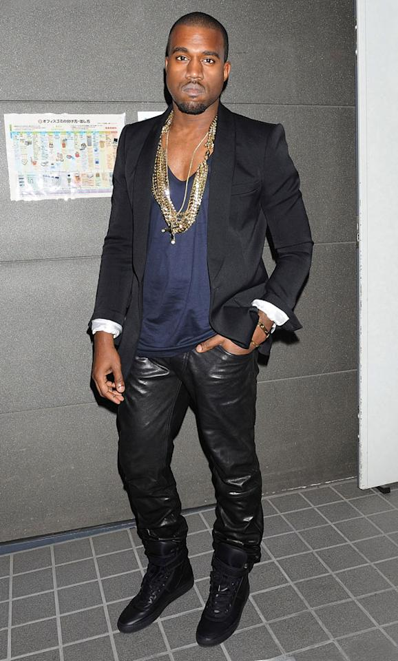 "Fellow fashion-challenged performer Kanye West took Tokyo by surprise when he showed up for a screening of his short film, ""Runaway,"" in baggy leather pants, an unsightly scoop-neck shirt, and more bling than Mr. T ever dared to don. Jun Sato/<a href=""http://www.wireimage.com"" target=""new"">WireImage.com</a> - October 8, 2010"