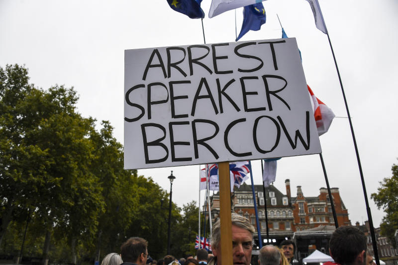A placard reading 'arrest Breach now' is pictured outside the Houses of Parliament, in London, Monday, Oct. 14, 2019.(AP Photo/Alberto Pezzali)