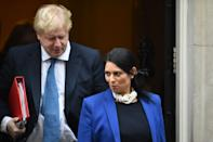 British foreign minister Boris Johnson and Britain's International Development Secretary Priti Patel leave the weekly meeting of the cabinet at 10 Downing Street in central London on January 31, 2017. / AFP / Glyn KIRK (Photo credit should read GLYN KIRK/AFP via Getty Images)