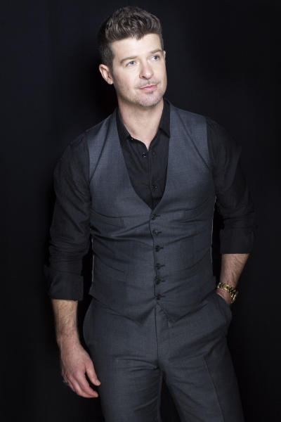 """This Aug. 1, 2013 photo shows R&B singer-songwriter Robin Thicke in New York. Thicke released his fifth album, """"Blurred Lines,"""" on Aug. 2. The title track and lead single, which features T.I. and Pharrell, is the longest-running No. 1 song on the Billboard Hot 100 chart so far this year. (Photo by Victoria Will/Invision/AP)"""