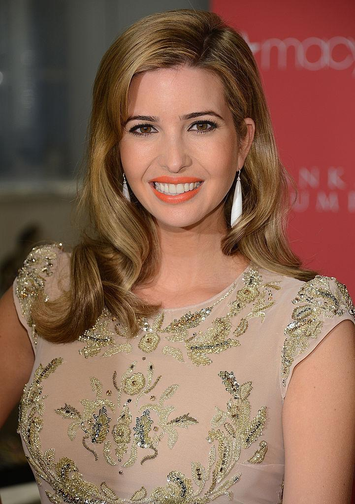 <p>Ivanka goes Old Hollywood glam with bright orange lips and copper-blond-highlighted hair. (Photo: Getty Images) </p>