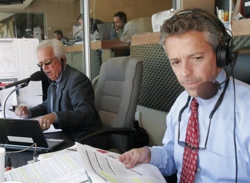 After Reds announcer Thom Brennaman uttered a gay slur on air Wednesday, both he and his father — former announcer Marty Brennaman, left — insisted that it didn't reflect who he is. (AP Photo/David Kohl)