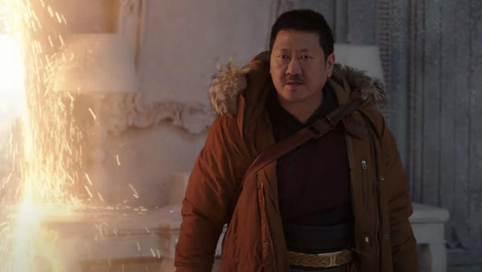 Wong wears winter clothes next to a portal