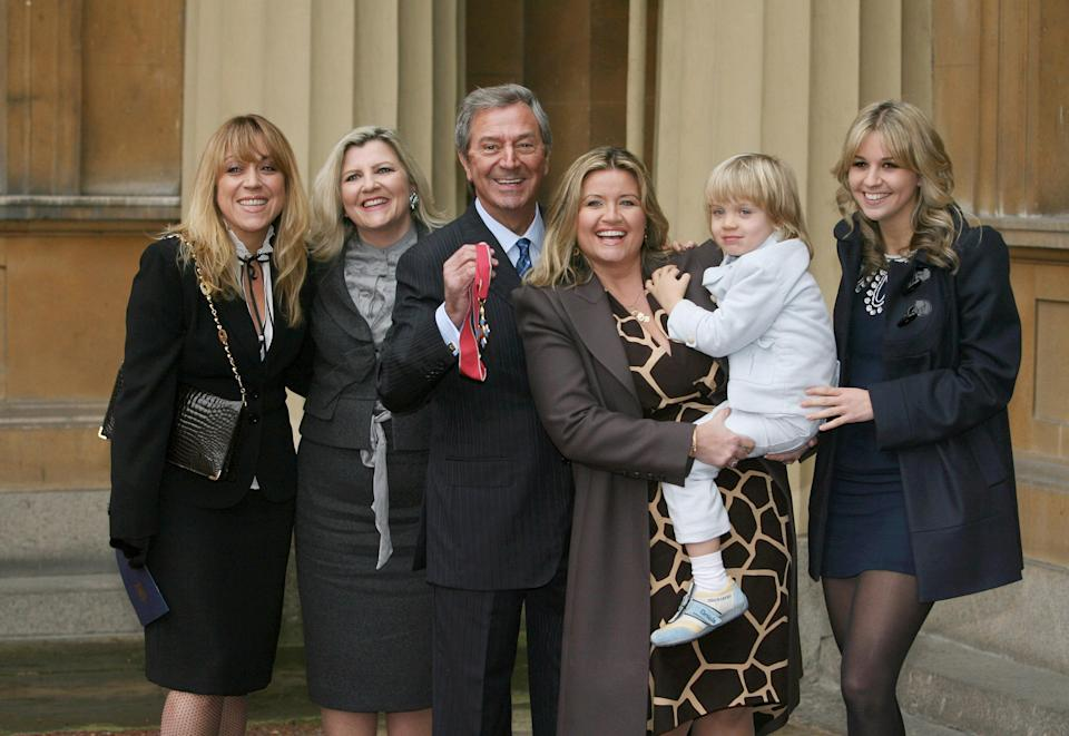 File photo dated 02/12/08 of veteran entertainer Des O'Connor with his (left to right) daughters Samantha and Karen, wife Jodie, son Adam, 4, and daughter Kristina, receiving his CBE at Buckingham Palace, London. Des O'Connor sadly passed away on Saturday 14 November aged 88. His agent confirmed he had been admitted to hospital just over a week ago, following a fall at his home in Buckinghamshire. Unfortunately yesterday evening his condition suddenly deteriorated and he drifted peacefully away in his sleep.