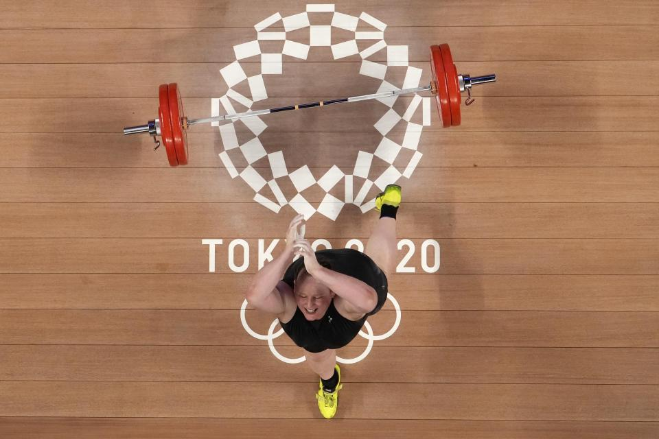Laurel Hubbard of New Zealand drops the barbell during a lift, in the women's +87kg weightlifting event at the 2020 Summer Olympics, Monday, Aug. 2, 2021, in Tokyo, Japan. (AP Photo/Luca Bruno)