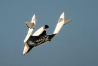 FILE PHOTO: File photo of Virgin Galactic's SpaceShipTwo flies over the Mojave Desert shortly before successfully completing a test flight that broke the sound barrier