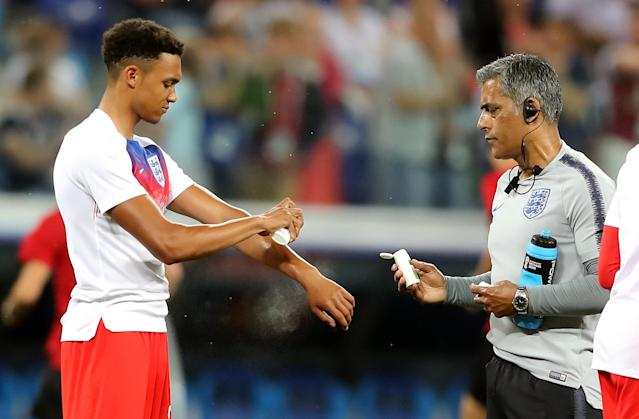 <p>England's Trent Alexander-Arnold (left) sprats insect repellent before the FIFA World Cup Group G match at The Volgograd Arena, Volgograd. (Photo by Owen Humphreys/PA Images via Getty Images) </p>