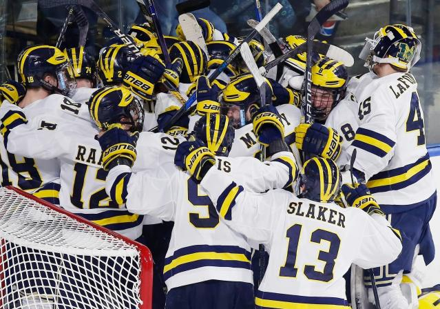 Michigan players celebrate after defeating Boston University 6-3 in the NCAA northeast regional championship hockey game in Worcester, Mass. Five years in to its existence, the Big Ten's presence has finally been felt in college hockey. (AP Photo/Michael Dwyer, File)