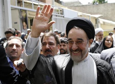 Former president Khatami arrives to vote during the Iranian presidential election in northern Tehran