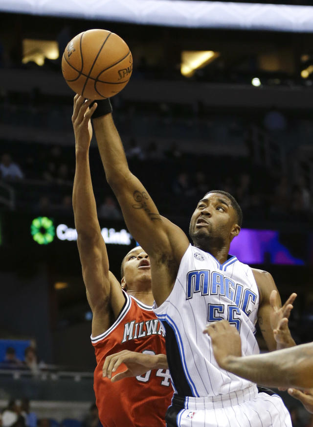 Orlando Magic's E'Twaun Moore, right, goes up for a rebound against Milwaukee Bucks' Giannis Antetokounmpo, left, of Greece, during the first half of an NBA basketball game in Orlando, Fla., Wednesday, Nov. 13, 2013. (AP Photo/John Raoux)