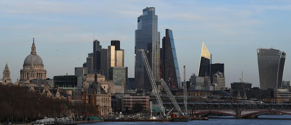 The skyline of the City of London is seen in the evening sunlight on December 17, 2020. - Stock markets mostly gained Thursday as investors kept an eye on US stimulus progress and the rollout of vaccines but surging infections and new lockdowns tempered gains. The pound held around 19-month highs against the dollar as the Bank of England held fire over interest rates and stimulus as Britain and the EU continue their 11th-hour talks on their post-Brexit trading arrangement. (Photo by DANIEL LEAL-OLIVAS / AFP) (Photo by DANIEL LEAL-OLIVAS/AFP via Getty Images)