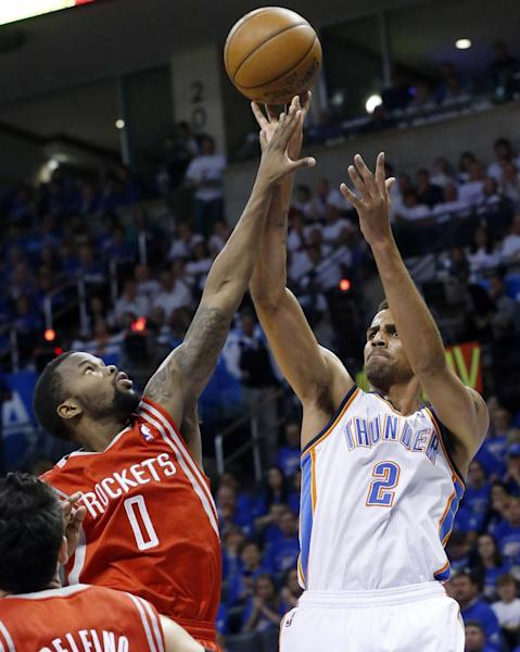 Oklahoma City Thunder guard Thabo Sefolosha (2) shoots over Houston Rockets guard Aaron Brooks in the third quarter of Game 2 of their first-round NBA basketball playoff series in Oklahoma City, Wednesday, April 24, 2013. Oklahoma City won 105-102. (AP Photo/Sue Ogrocki)