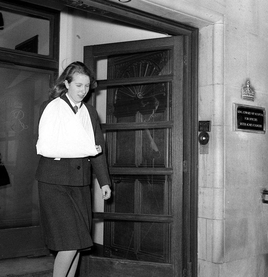 "<p>Leaving the Beaumont Housing Nursing Home after sustaining an injury from a <a href=""https://www.nytimes.com/1964/12/09/archives/princess-anne-injures-hand-in-a-horseriding-accident.html"" target=""_blank"">horse riding accident</a>.</p>"