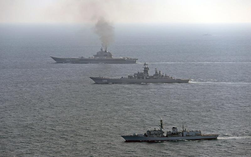 HMS St Albans (foreground), seen here with the Russian Warships Petr Velikiy (centre) and the Admiral Kuznetsov (background) - Credit: Dave Jenkins/Dave Jenkins
