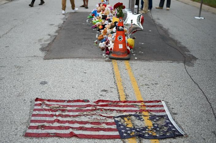A makeshift memorial in the street during a memorial service for 18-year-old Michael Brown Jr. on August 9, 2015, at the Canfield Apartments in Ferguson, Missouri (AFP Photo/Michael B. Thomas)