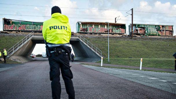 PHOTO: A police officer looks on near a damaged cargo train compartment near the Storebaelt bridge, near Nyborg in Denmark, Jan. 2, 2019. (Michael Bager/Ritzau Scanpix via AP)