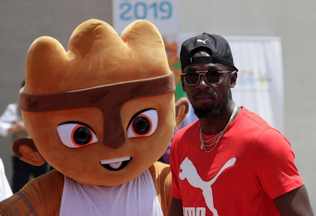 Usain Bolt visits the remodeled Atletico de la VIDENA Stadium and poses with Milco the mascot, in Lima, Peru April 3, 2019 REUTERS/Henry Romero