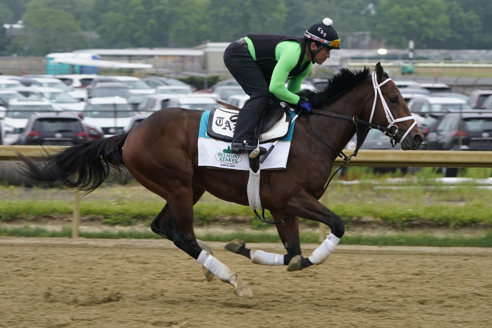 Overtook trains ahead of the 153rd running of the Belmont Stakes horse race in Elmont, N.Y., Thursday, June 3, 2021. (AP Photo/Seth Wenig)