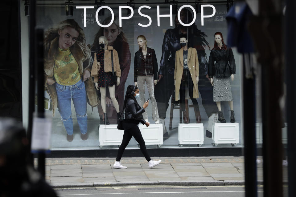 Mannequins with and without face masks in a store window at Topshop. - Credit: AP