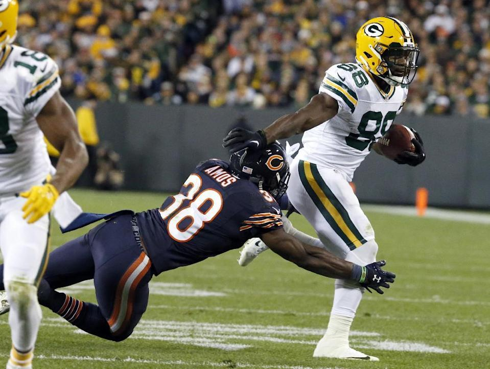 Green Bay Packers wide receiver Ty Montgomery pushes Chicago Bears free safety Adrian Amos away as he carries the ball. (AP Photo/Mike Roemer)