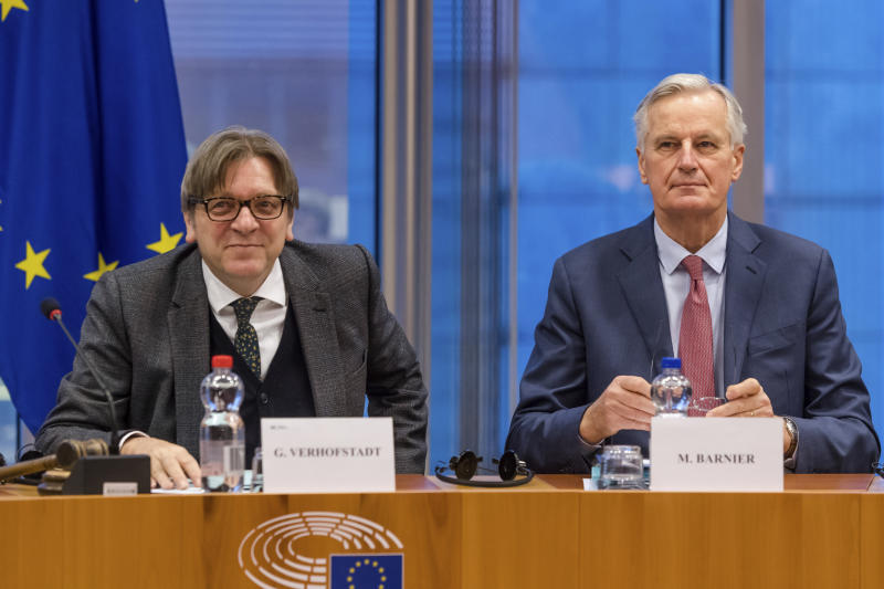 European Parliament Brexit coordinator Guy Verhofstadt left and European Union chief Brexit negotiator Michel Barnier talk at the start of a Brexit Steering Group meeting at the European Parliament in Brussels on Wednesday Jan. 30 2019. British Prime M