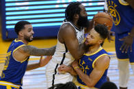 Brooklyn Nets guard James Harden, middle, is fouled by Golden State Warriors guard Stephen Curry, right, during the first half of an NBA basketball game in San Francisco, Saturday, Feb. 13, 2021. At left is Warriors guard Mychal Mulder. (AP Photo/Jeff Chiu)