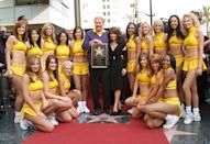 Dr. Jerry Buss (C), poses with former Laker girl Paula Abdul and the current Laker Girls after Buss is honored with a television star on the Hollywood Walk of Fame on October 30, 2006 in Hollywood, California. (Photo by Andrew D. Bernstein/NBAE/Getty Images)