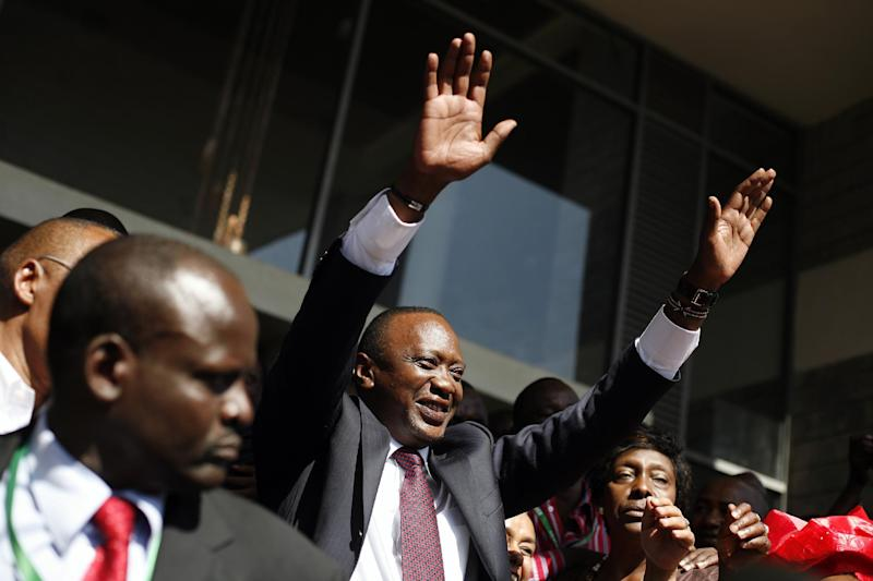 FILE - In this Saturday March 9, 2013 file photo, Kenyan president elect Uhuru Kenyatta waves at supporters after winning the election in Nairobi, Kenya. Prosecutors at the International Criminal Court have asked judges not to reject their faltering case against Kenyan President Uhuru Kenyatta entirely, despite acknowledging they do not have enough evidence to convict him. Defense lawyers have demanded acquittal. Presiding Judge Kuniko Ozaki said the panel hearing the case in The Hague, Netherlands, will not decide the matter Wednesday Feb. 5, 2014. (AP Photo/Jerome Delay, File)