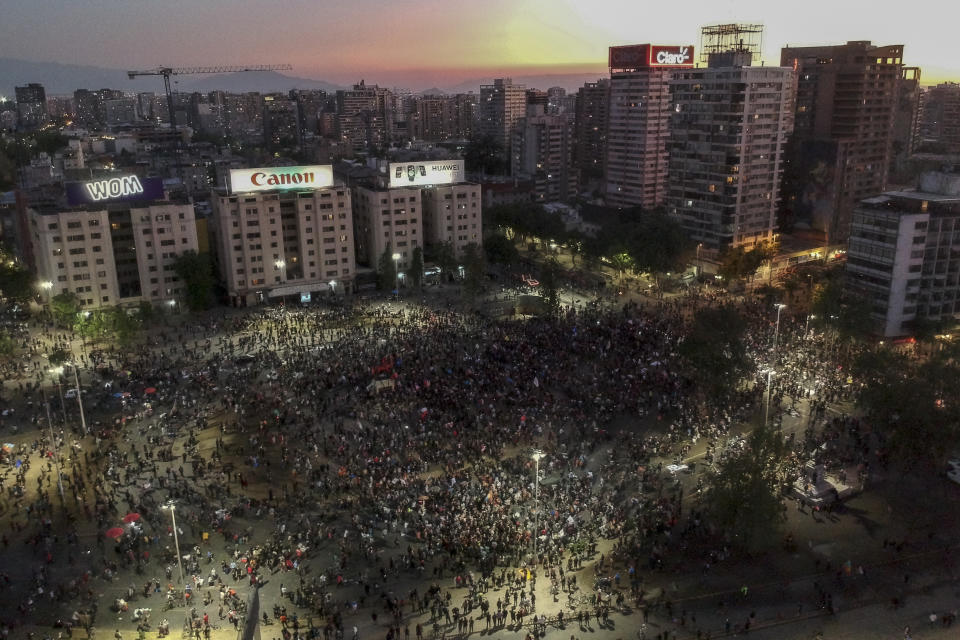 A drone view of aerial view of people gather at Plaza Baquedano on the day Chileans voted in a referendum to decide whether the country should replace its 40-year-old constitution, written during the dictatorship of Gen. Augusto Pinochet, in Santiago, Chile, Sunday, Oct. 25, 2020 (Photo by Pablo Rojas Madariaga/NurPhoto via Getty Images)