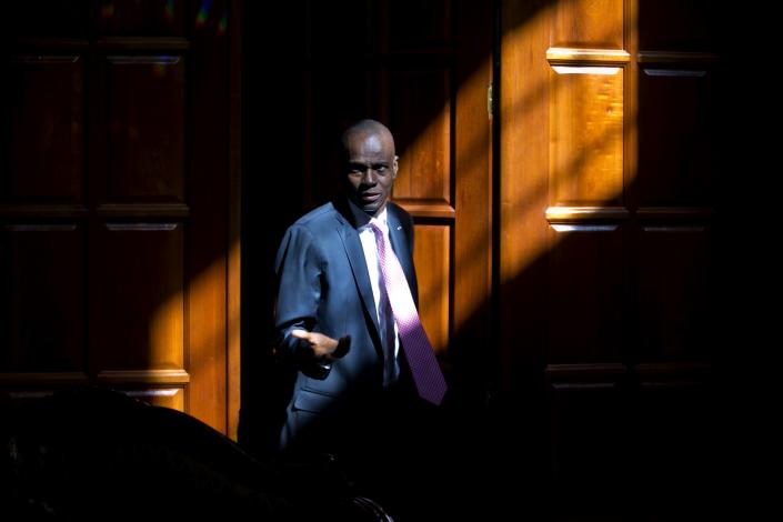 FILE - In this Feb. 7, 2020 file photo, Haitian President Jovenel Moise arrives for an interview at his home in Petion-Ville, a suburb of Port-au-Prince, Haiti. Moïse was assassinated in an attack on his private residence early Wednesday, July 7, 2021, and first lady Martine Moïse was shot in the overnight attack and hospitalized, according to a statement from the country's interim prime minister. (AP Photo/Dieu Nalio Chery, File)