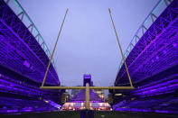 """An outdoor dining tent set up at Lumen Field, the home of the Seattle Seahawks NFL football team, is shown as viewed from the south end zone, Thursday, Feb. 18, 2021, in Seattle. The """"Field To Table"""" event was the first night of several weeks of dates that offer four-course meals cooked by local chefs and served on the field at tables socially distanced as a precaution against the COVID-19 pandemic, which has severely limited options for dining out at restaurants in the area. (AP Photo/Ted S. Warren)"""