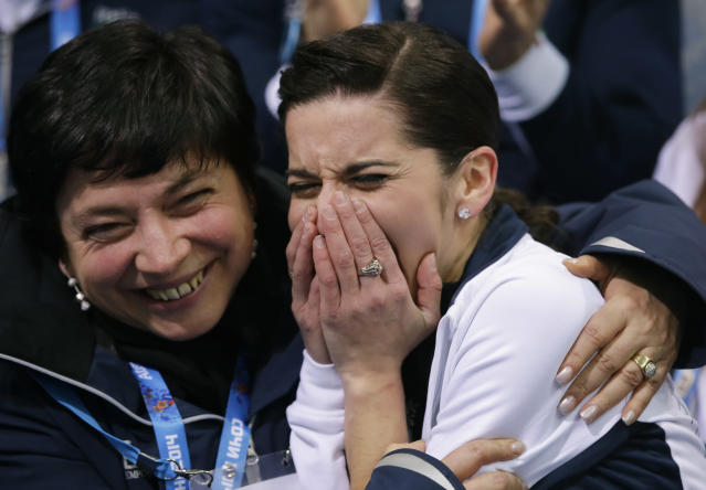 Valentina Marchei of Italy, right, reacts in the results area after competing in the women's team free skate figure skating competition at the Iceberg Skating Palace during the 2014 Winter Olympics, Sunday, Feb. 9, 2014, in Sochi, Russia. (AP Photo/Darron Cummings, Pool)