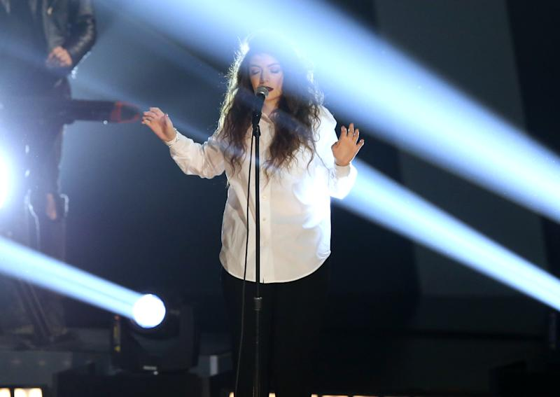 "Lorde performs ""Royals"" at the Grammy Nominations Concert Live! on Friday, Dec. 6, 2013, at the Nokia Theatre L.A. Live in Los Angeles. (Photo by Matt Sayles/Invision/AP)"