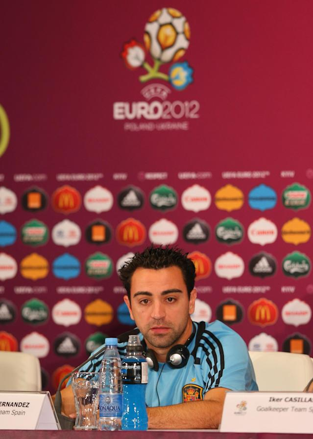 KIEV, UKRAINE - JUNE 30: In this handout image provided by UEFA, Xavi Hernandez of Spain talks to the media during a UEFA EURO 2012 press conference at the Olympic Stadium on June 30, 2012 in Kiev, Ukraine. (Photo by Handout/UEFA via Getty Images)