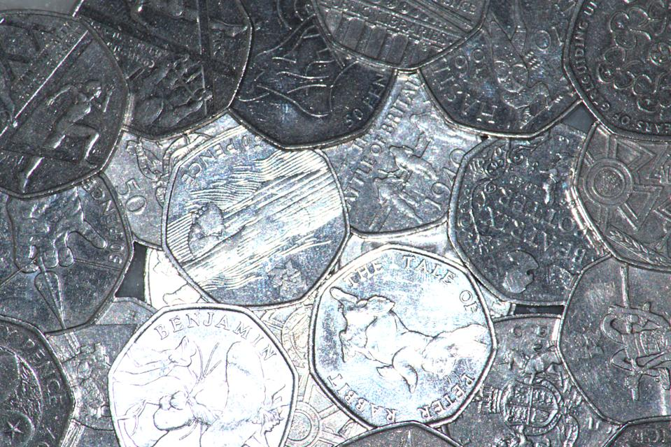 Image of the reverse view of a number of commemorative UK fifty pence coins.