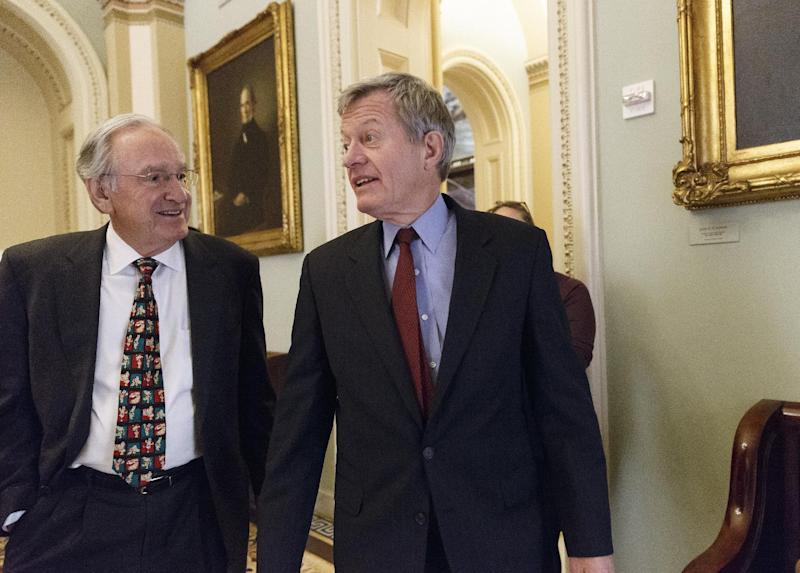 Senate Finance Committee Chairman Max Baucus, D-Mont., right, walks with Sen. Tom Harkin, D-Iowa, left, to a Democratic Caucus lunch at the Capitol in Washington, Thursday, Dec. 19, 2013. Baucus, who announced earlier this year that he would not seek re-election, is President Barack Obama's choice to be the next U.S. ambassador to China. (AP Photo/J. Scott Applewhite)