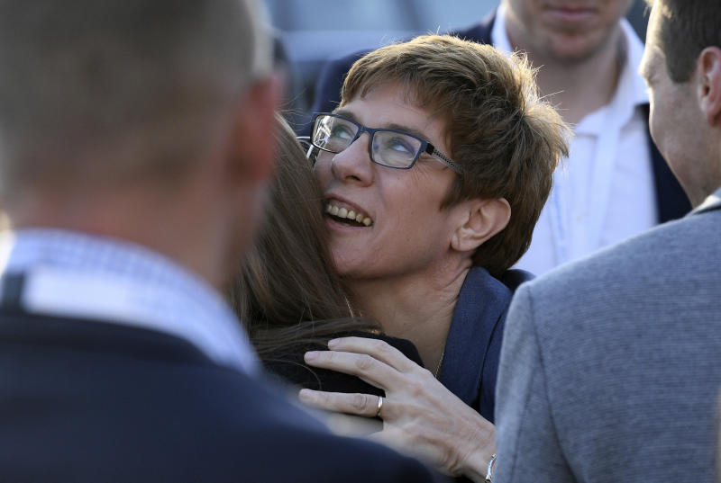 Saarland governor Annegret Kramp-Karrenbauer of the Christian Democratic party is congratulated after the election in the German state of Saarland in Saarbruecken, Sunday, March 26, 2017. Chancellor Angela Merkel's conservative party has emerged easily as the strongest party from an election in Germany's western Saarland state — an unexpectedly strong performance and a disappointment for her center-left rivals. ( Boris Roessler/dpa via AP)