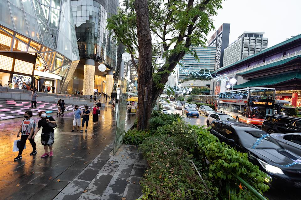 Pedestrians along Orchard Road in Singapore.