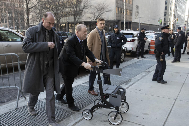 Harvey Weinstein, second from left, arrives at court for his trial on charges of rape and sexual assault, Friday, Jan. 24, 2020, in New York. (AP Photo/Mark Lennihan)