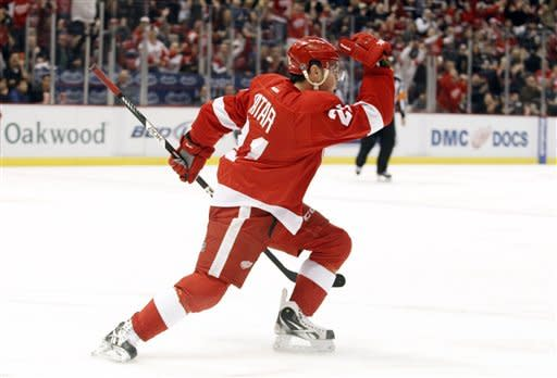 Detroit Red Wings center Tomas Tatar (21), of the Czech Republic, celebrates his second-period goal against the Anaheim Ducks during an NHL hockey game on Friday, Feb. 15, 2013, in Detroit. (AP Photo/Duane Burleson)