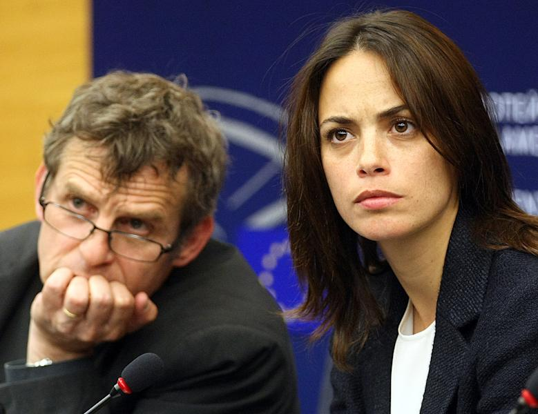 French actress Berenice Bejo, right, and Belgian director Lucas Belvaux address the media at the European parliament in Strasbourg, eastern France, Tuesday June 11, 2013, after their meeting with EU officials asking that audiovisual services be kept off the table during upcoming EU-US free-trade negotiations. A cloud is hanging over the upcoming free-trade talks between the European Union and the United States after France said it won't back any deal that threatens the country's prestigious film, radio or TV industries. (AP Photo/Christian Lutz)